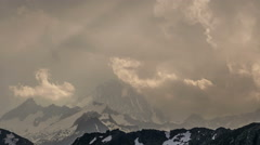 Finsteraarhorn snow covered peak Bernese Oberland storm covering mountain - stock footage