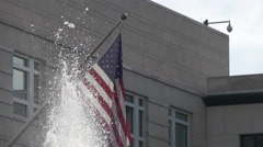 USA flag and fountain in Parizer Platz, Berlin Stock Footage