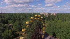 A Ferris wheel in Pripyat, near Chernobyl (Aerial, 4K) - stock footage