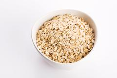 Oat flakes in bowl - stock photo