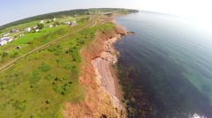 Aerial travelling along shoreline in Gaspe Peninsula Stock Footage