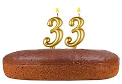 Birthday cake candles number 33 isolated Stock Photos