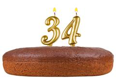 birthday cake candles number 34 isolated - stock photo