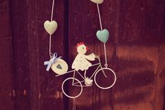 Decor object with girl riding a bike Stock Photos