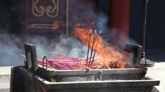 Incense flames, Buddhist temple, China Stock Footage