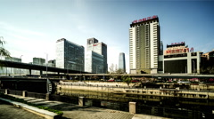 The busy traffic and buildings near the Tonghui River of Beijing, China. Stock Footage