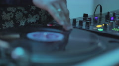 Deejay hand scratching, spinning platter, playing, mixing melody Stock Footage