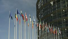 Establishing shot of European Union country flags on the left with European Stock Footage