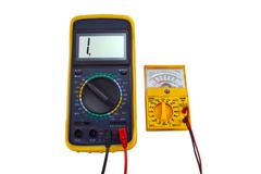 Digital and pointer multimeters - stock photo