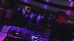 Guy playing music, many people clubbing, moving on dancefloor Stock Footage