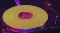 Closeup of record rotating on deejay turntable, lights flashing - stock footage