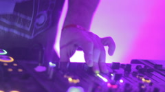 Close-up of male deejay hands tweaking controls on sound deck - stock footage