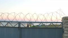 Private property. Gate with barbed wire on the top Stock Footage