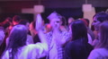 Guys having fun, performing crazy dance at nightclub, partying HD Footage