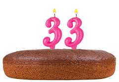 birthday cake with candles number 33 isolated - stock photo