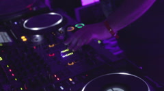 Stock Video Footage of Male disk jockey switching controls, pressing buttons, turntable