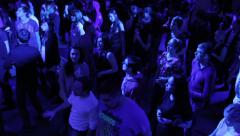 Young guys relaxing, having fun, moving to music on dance floor Stock Footage