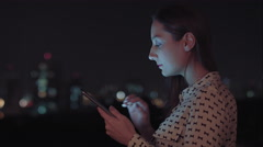 A beautiful woman using your tablet to send a message Stock Footage