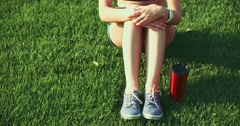 Female feet in sneakers gumshoes, close up. Slow motion, 120fps. - stock footage