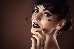 Elegant Beauty Model with Black Makeup with veil Stock Photos