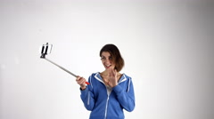 Pretty girl taking selfie with stick Stock Footage