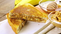 Homemade peanut butter and banana  sandwich on white bread. Stock Footage