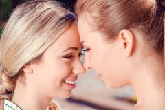 Close up of lesbian couple outdoors Stock Photos