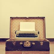 Stock Photo of old typewriter in an old suitcase, with a retro effect