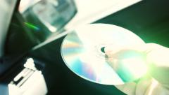 Stock Video Footage of Beam of the sun is reflected in a compact disk and reflected as in a mirror