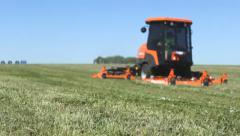 Lawn mowers on grass fielld 1 Stock Footage