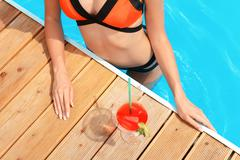 Top view of woman at poolside Stock Photos