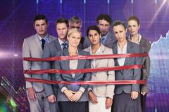 Composite image of upset business team fastened with adhesive tape Stock Photos