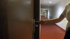 A woman opening a hotel door Stock Footage