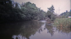1971: Cane fishing and catch with fish swim trap. Stock Footage