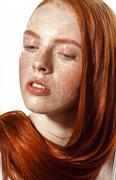 Beautiful ginger girl with clean skin. Red lips - stock photo