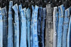 Row of hanged jeans - stock photo