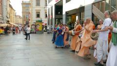 People from the Hare Krishna movement dancing and singing on the street 5 Stock Footage