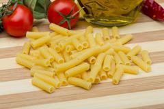 Raw rigatoni pasta - stock photo