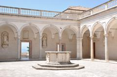 Courtyard Benedictine Monastery at Monte Cassino, a stone fountain and arcades Stock Photos