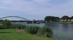 Arch Bridge across Zwarte Water river HASSELT, THE NETHERLANDS Stock Footage