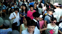 Tourist walking along the Nanluoguxiang shopping alley in downtown of Beijing Stock Footage