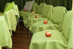 Apples on the chairs - stock photo