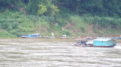 Local ferry boat across Mekong river, Laos Stock Footage