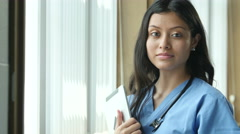 Young Hispanic nurse looking at camera, close up - stock footage
