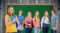 Composite image of a group of college students standing as one girl stands in - stock photo