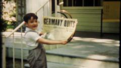 2419 - newspaper headlines, Germany Quits, Nazis Quit - vintage film home movie Stock Footage