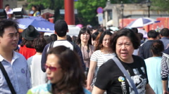 Crowd cross the street in the downtown of Beijing, China Stock Footage