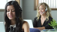 2 women customer service representatives working in an office Alissa - stock footage