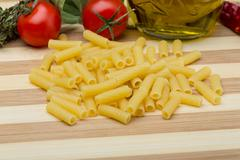 Raw rigatoni pasta - stock photo