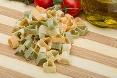 Raw heart-shaped pasta - stock photo